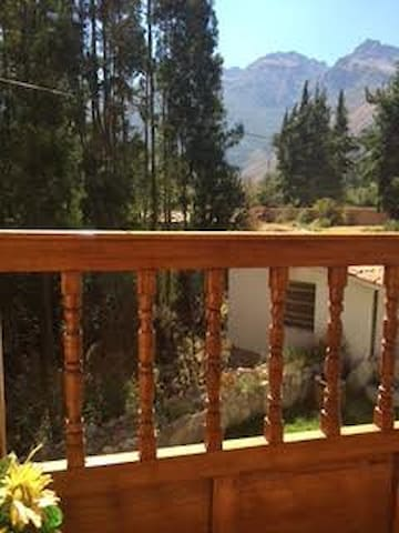 Enjoy the view of the woods and mountains from your balcony