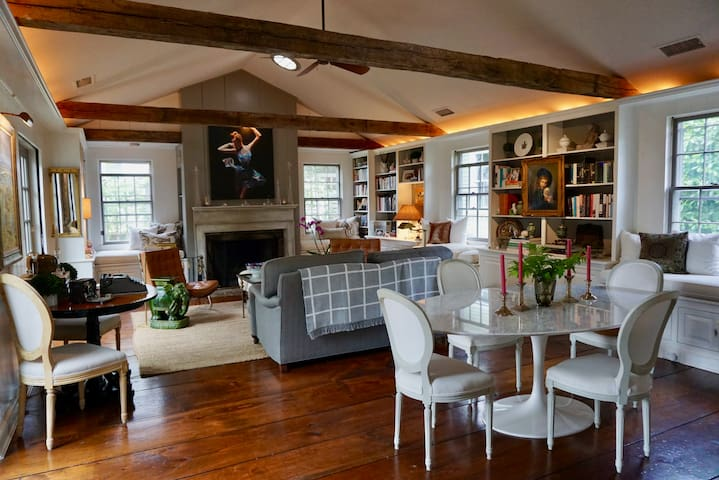 The Great Room - includes both Living and Dining areas, a wood burning fireplace, and two French doors that open to the patio