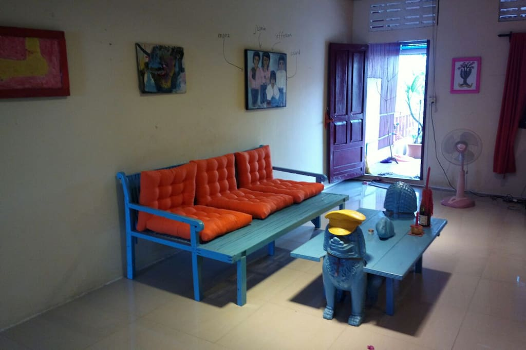 Stylish and selfmade sofa with the protective buddhist lion table