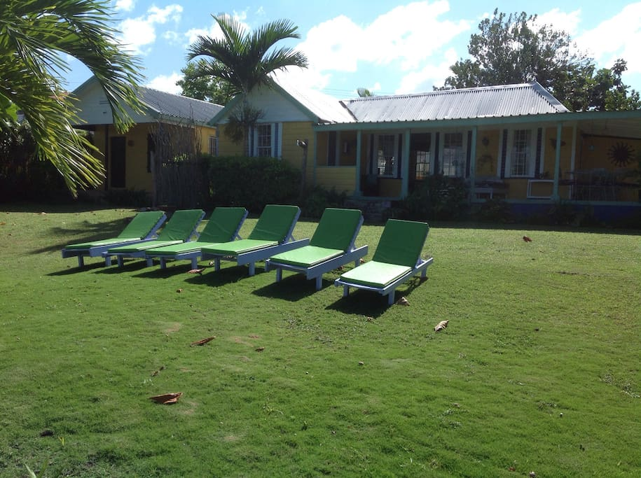 Front lawn with beach chairs to get that perfect sun tan.