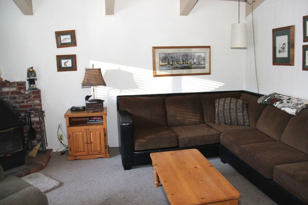 Mammoth Condo Rental Chateau Blanc 1 - Cozy Living Room with a new sofa and a Woodstove