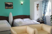 This is studio suitable for couple and small family. You can see kitchen, living area and 2 Queen bed. One Private bathroom attached with water boiler. Ps switch on the heater switch at least 15 min before you take shower.