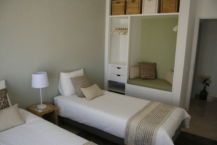 Small bedroom beds, nook and hangers