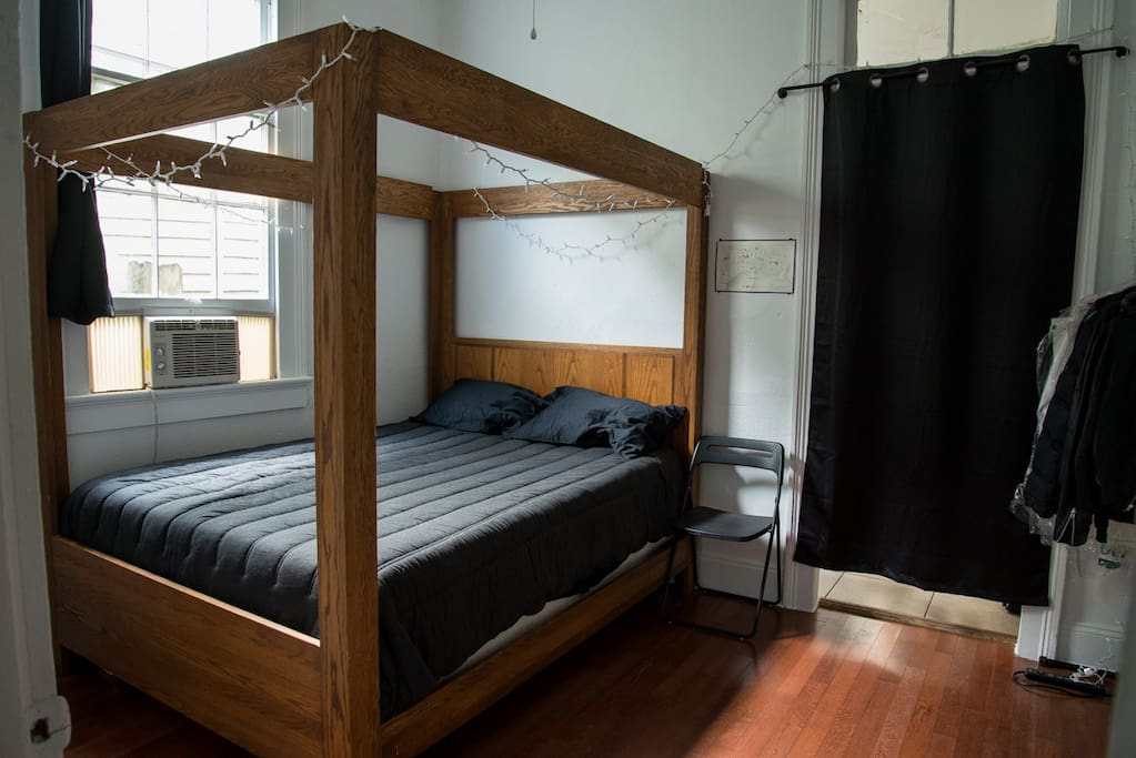 The bedroom has a Tempurpedic Mattress in a solid Oak four post bed frame.