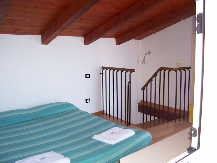 THE BEDROOM WITH THE BALCONY