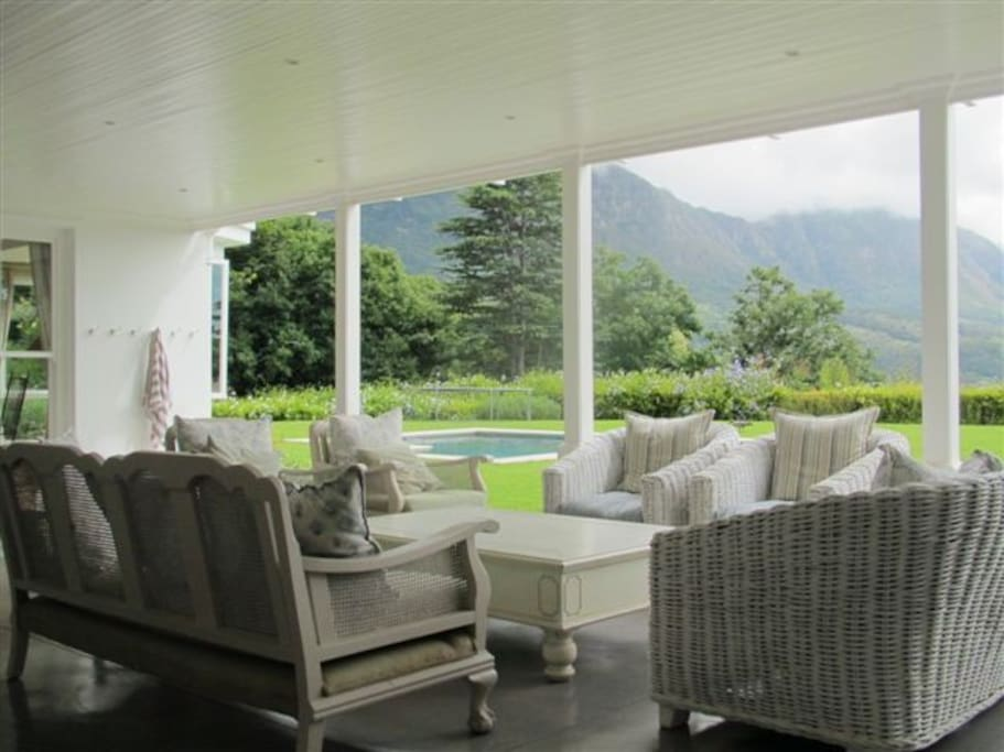 Covered outdoor terrace with garden and mountain views
