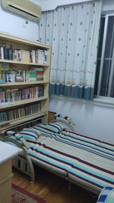 the sofa can be streched as a double bed.enough space for 1-2 people. with airconditioner and wife:)
