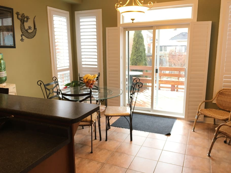Bright and warm kitchen with fresh fruits and seating for many. Walkout to the patio for a refreshing morning tea or a night BBQ.