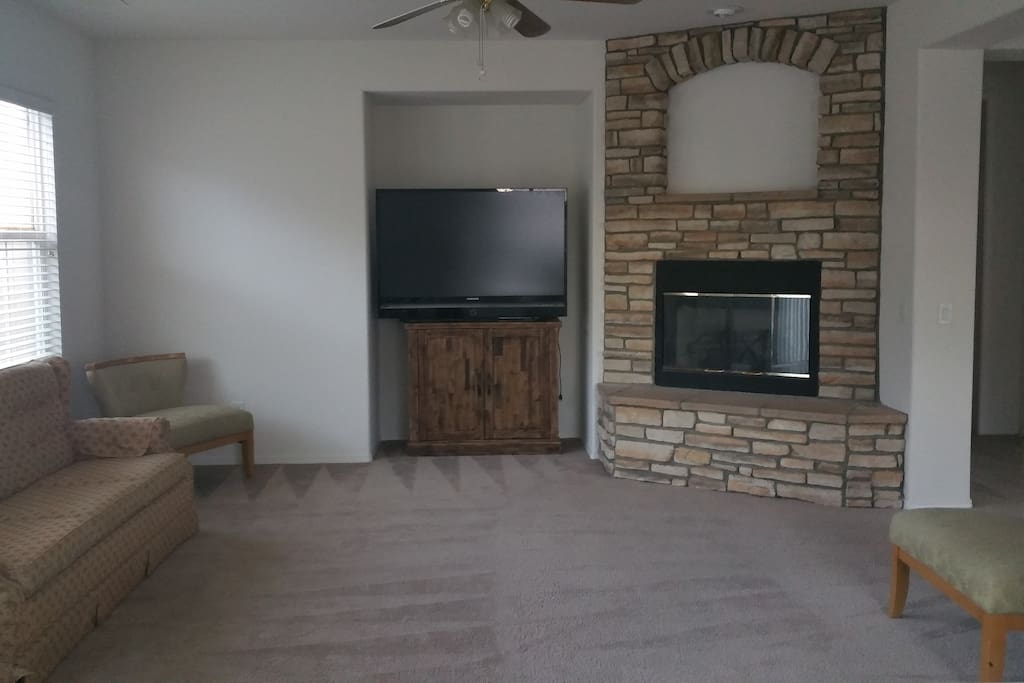 Family room fire place TV and stand