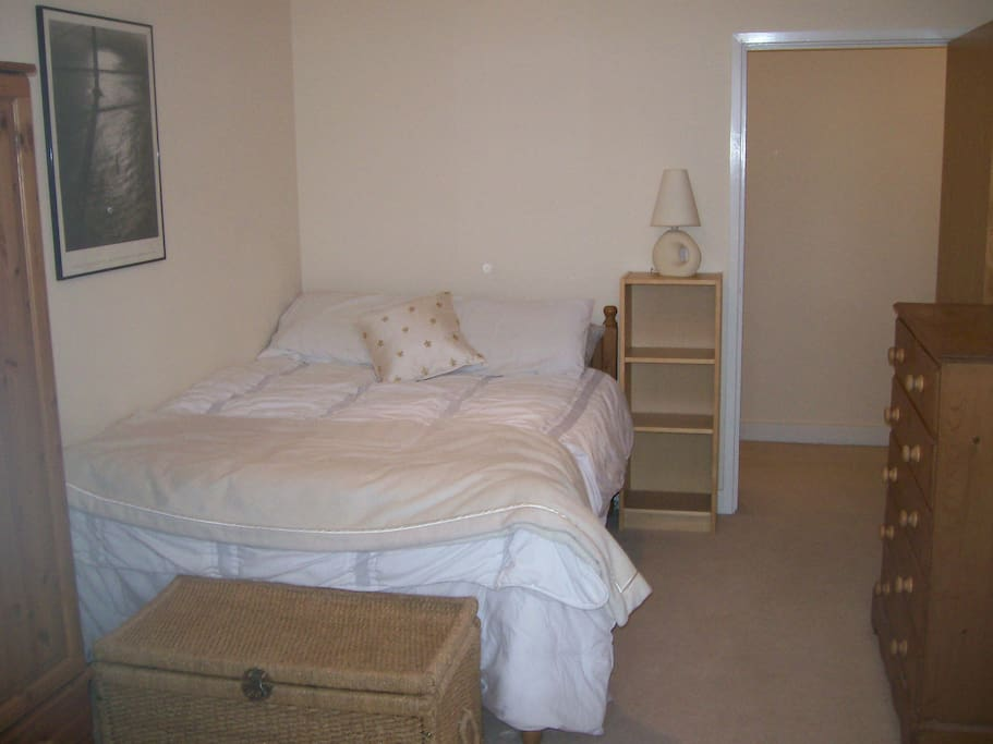 Spacious double bedroom with plenty of storage