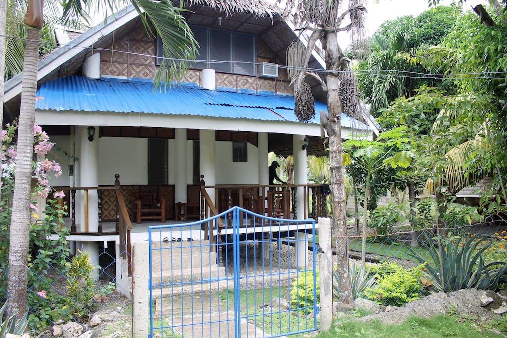 The entrance with garden and veranda/porch.