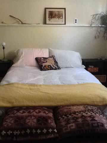 Firm double mattress, down duvet, choice of feather or foam pillows. Window into garden.