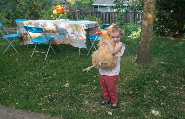 Nina holding one of our hens.