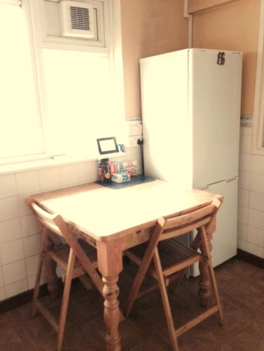 There is dining space for two guests in the kitchen