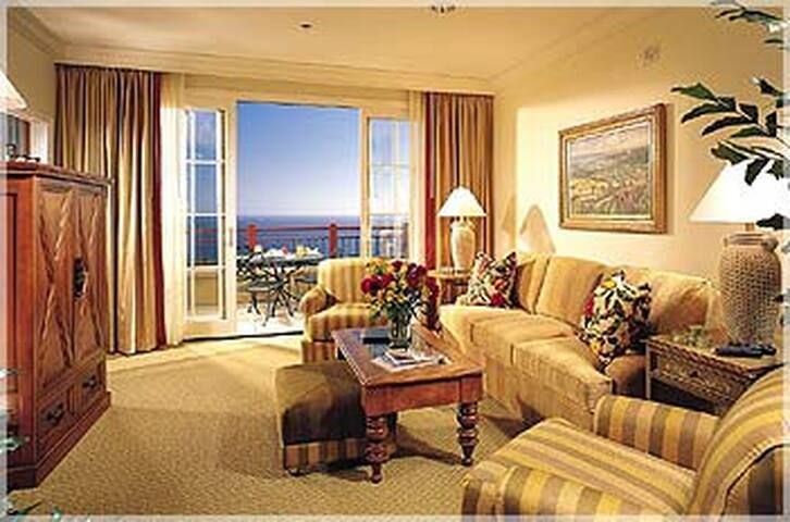 Spacious living room with balcony and panoramic view of Pacific