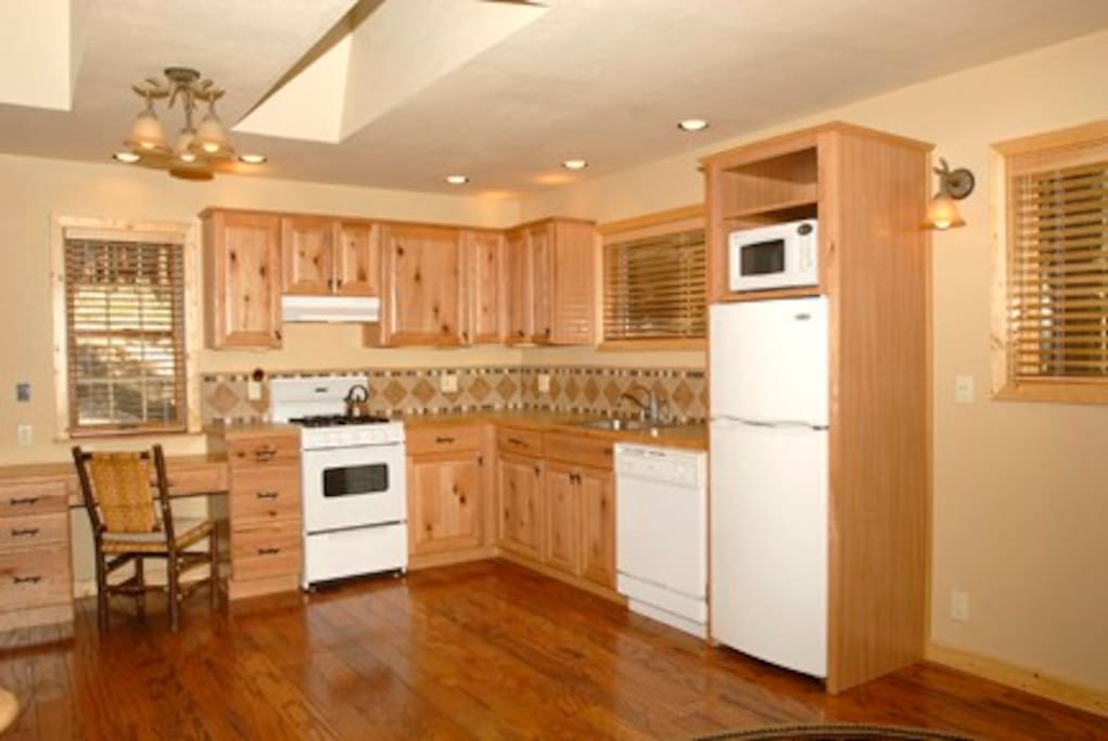 Fully equipped compact kitchen.