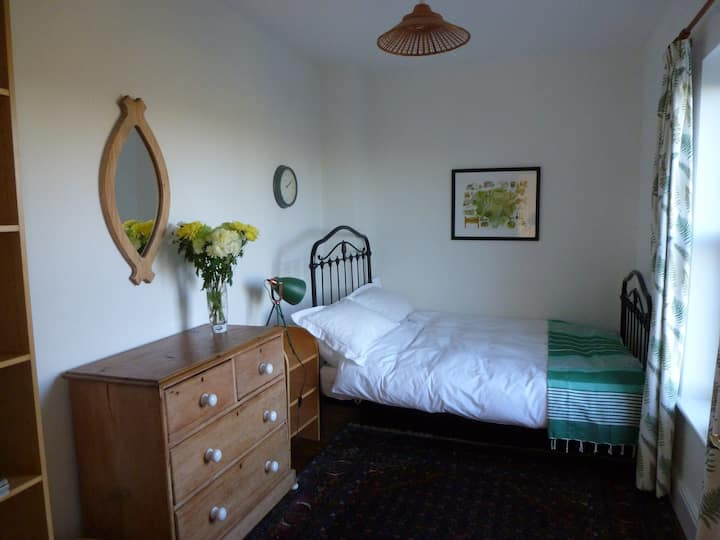 Peaceful bedroom in country house on working farm