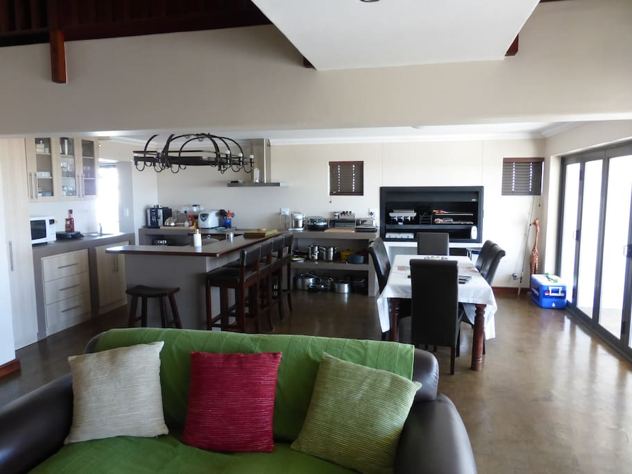 Open plan kitchen, diner & living room with build-in bbq.