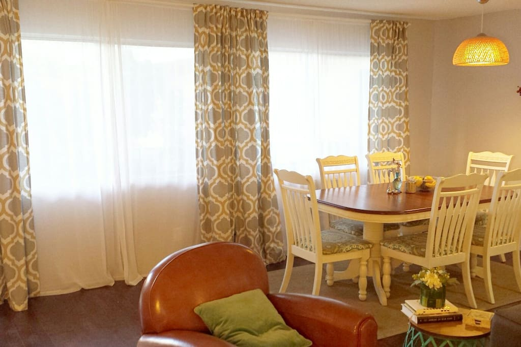 The spacious dining area has a large dining table that seats 6