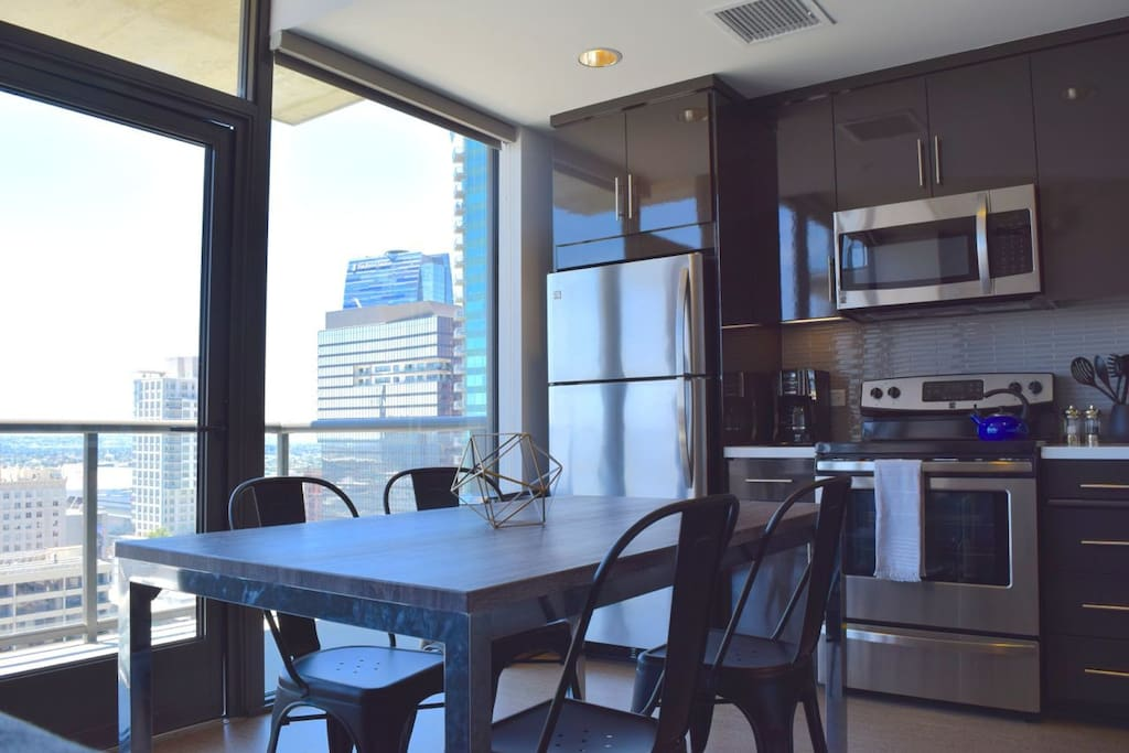 Your fully stocked kitchen with dining for four! The whole Flat is flooded with natural light