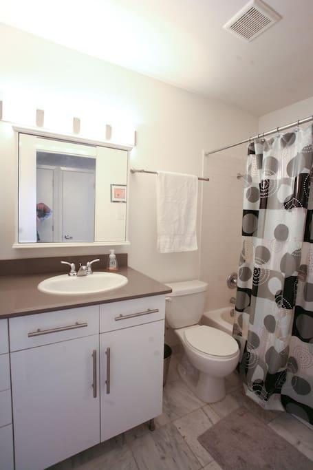 Bathroom has Italian marble floors with Silestone countertops.
