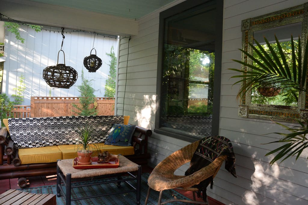 Front porch: seating, outdoor lights set to a timer and good vibes.