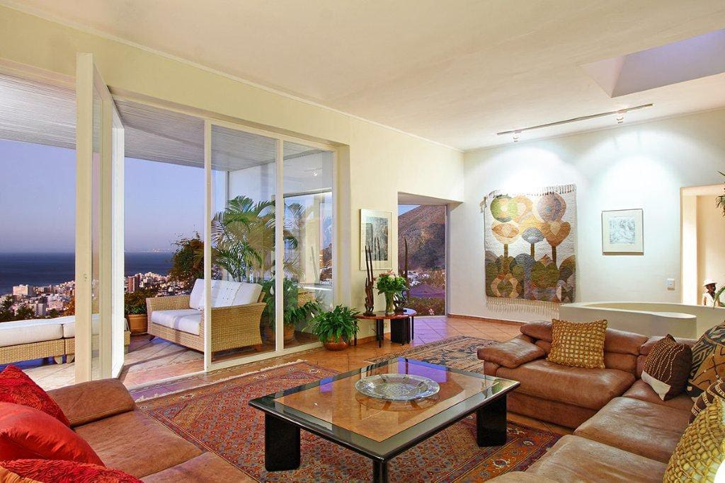 Open plan sitting room leading out onto sea facing terrace,