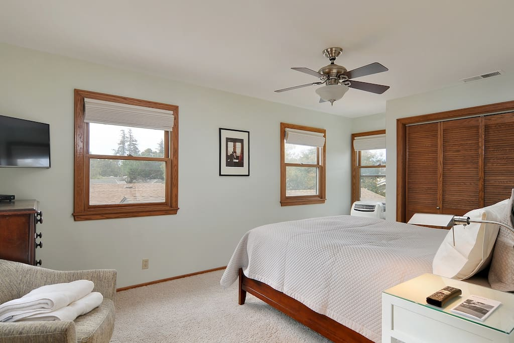 Your bedroom. Sleep in deep comfort on a Sterns and Foster luxury bed. Also included a TV, Wifi, AC, overhead fan, ambient lighting and lots of closet space