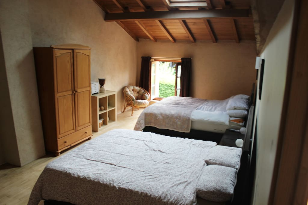 Exceptionally spacious, sunny bedroom with two double beds