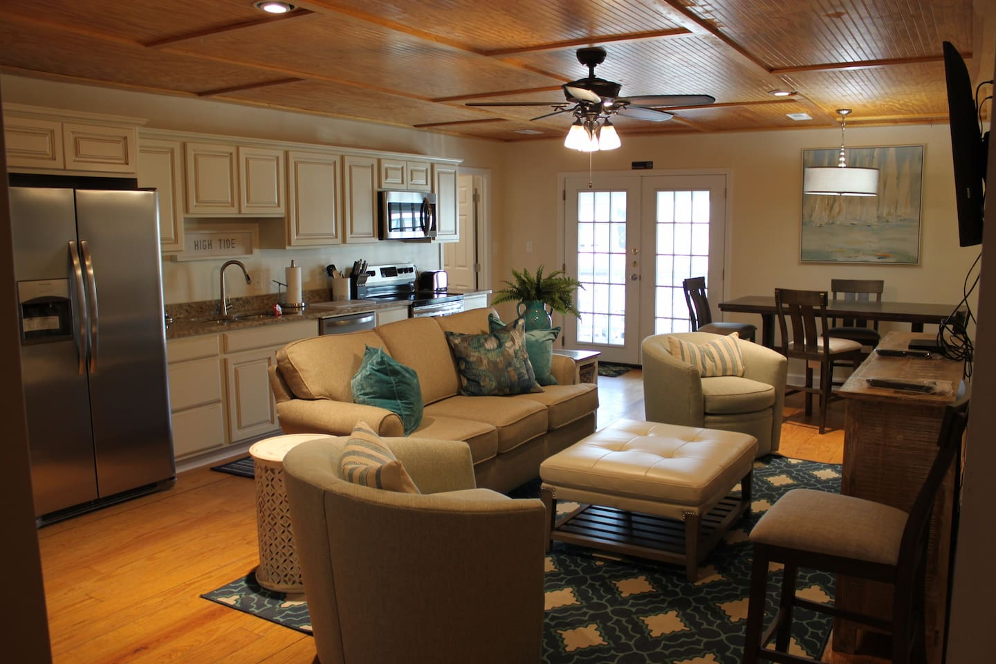 Main living area with fully functional kitchen.  Kitchen has full fridge, oven, stove top, microwave, and dishwasher.