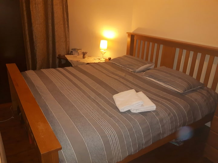 Small room with huge bed on Easter Road