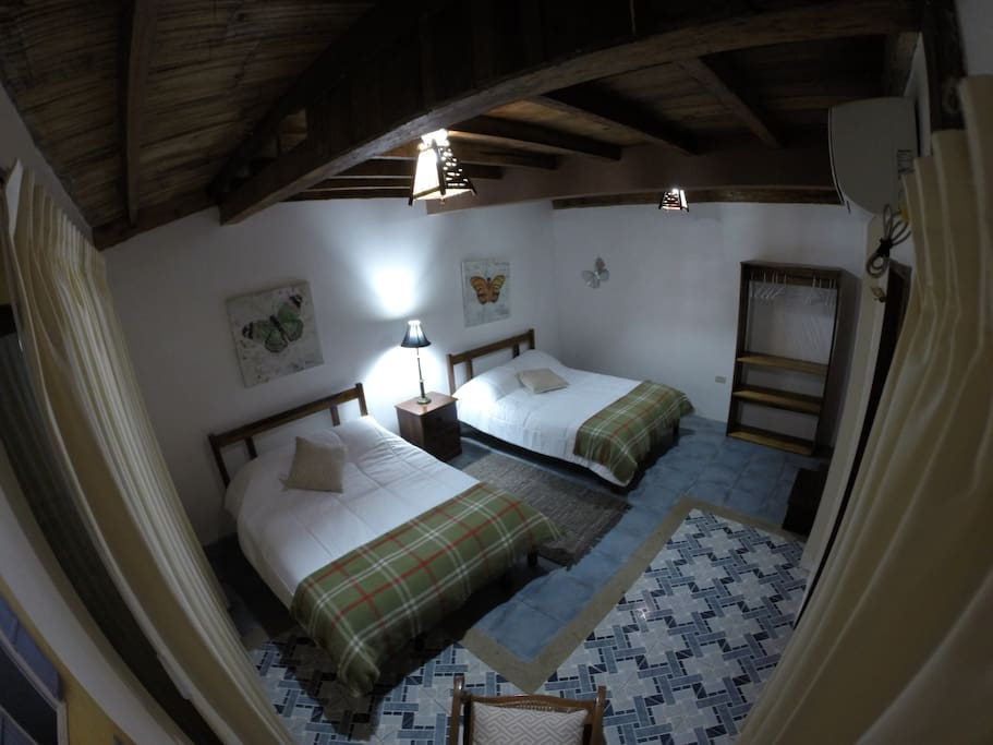 Stunning room with beach views equipped with 2 double beds. We can rearrange the room also with 1 double bed + 2 single beds if required. Capacity 4 guests. A/C, private balcony, wi- fi, hot water.