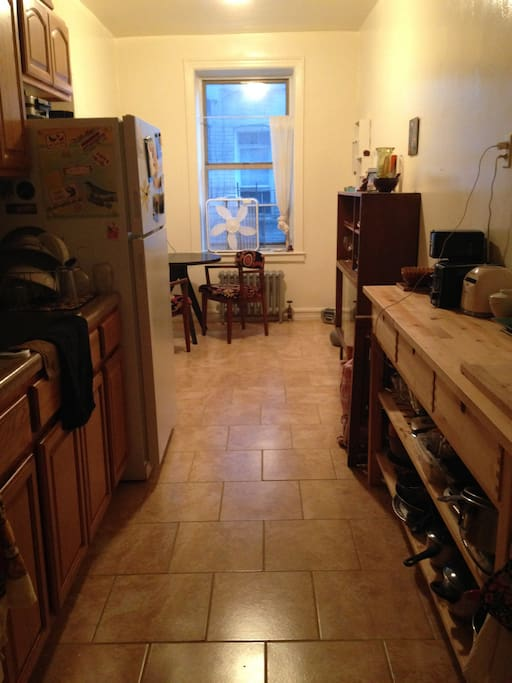 Eat-in kitchen with gas stove.