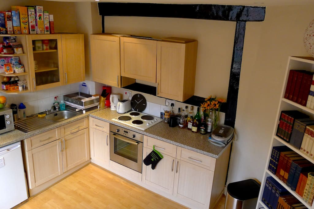 The kitchen has all the usual amenities and guests have access to their own refrigerator. There is also a washer + dryer.