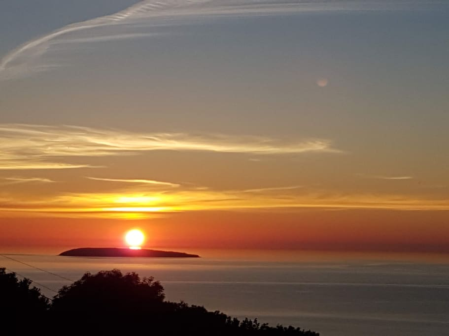 Sunset from my terrace towards the West over Puffin Island (Ynys Seiriol in Welsh).