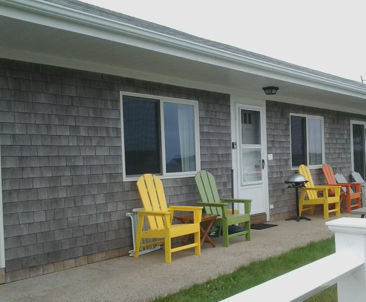 Front with private entrance, chairs, patio, picnic table & grill