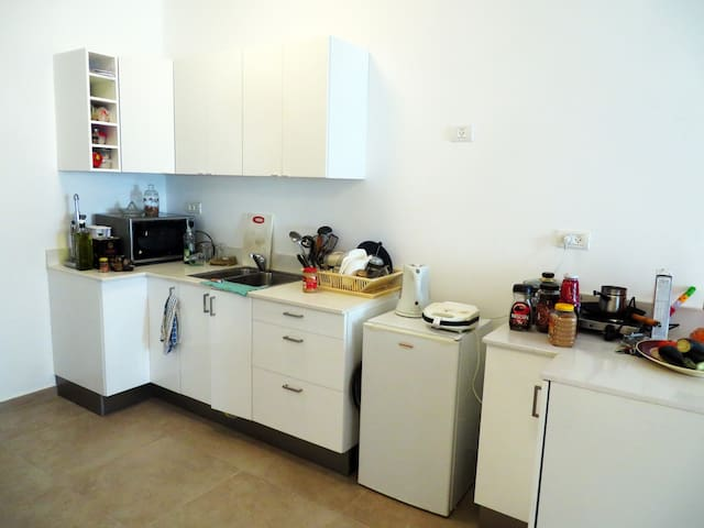 Kitchen. There is a new large fridge (not the one in the pic) and you are free to raid it.