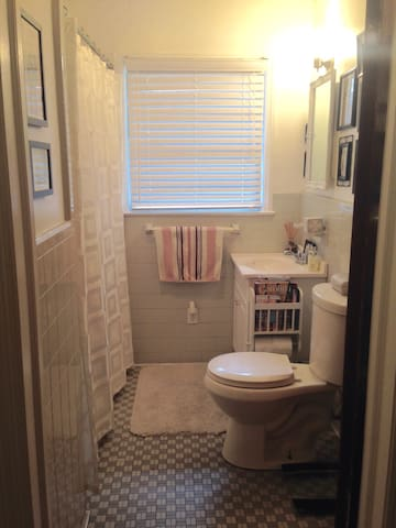 Bathroom with tub, shared between guests.