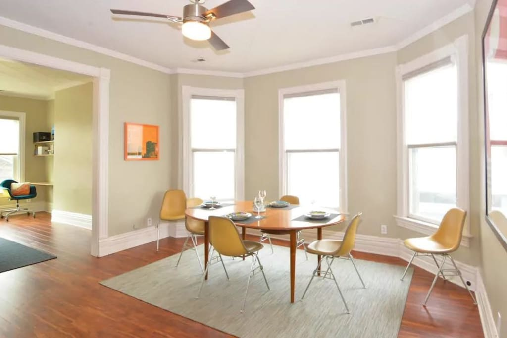 The separate dining room features an expandable table and vintage Herman Miller chairs.