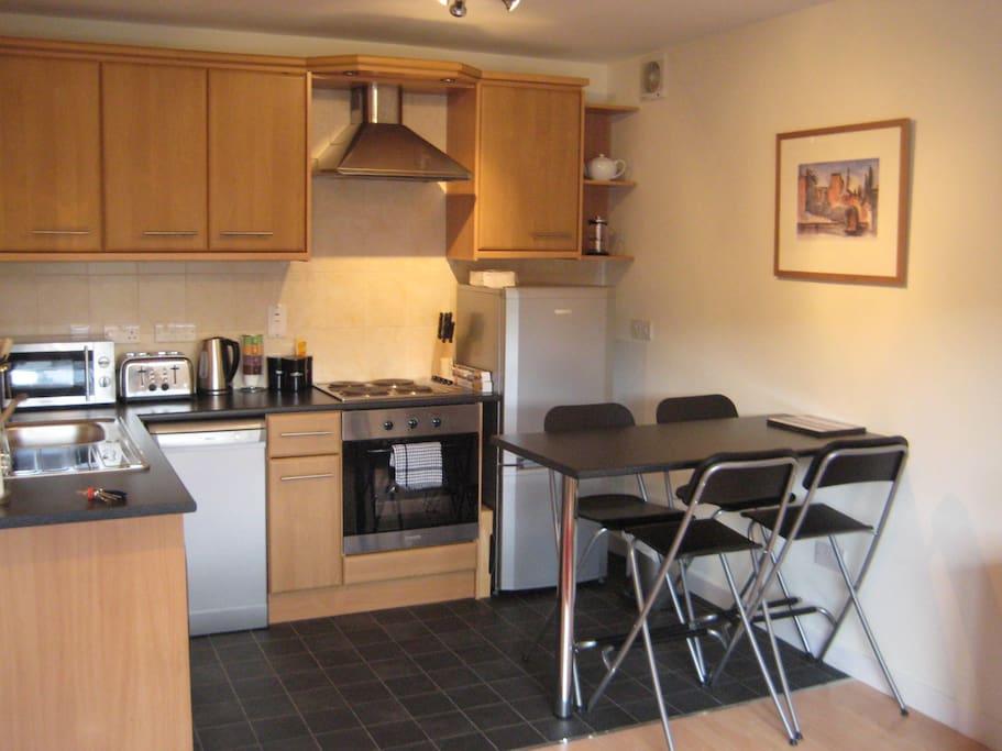 Open plan kitchenette with breakfast dining area