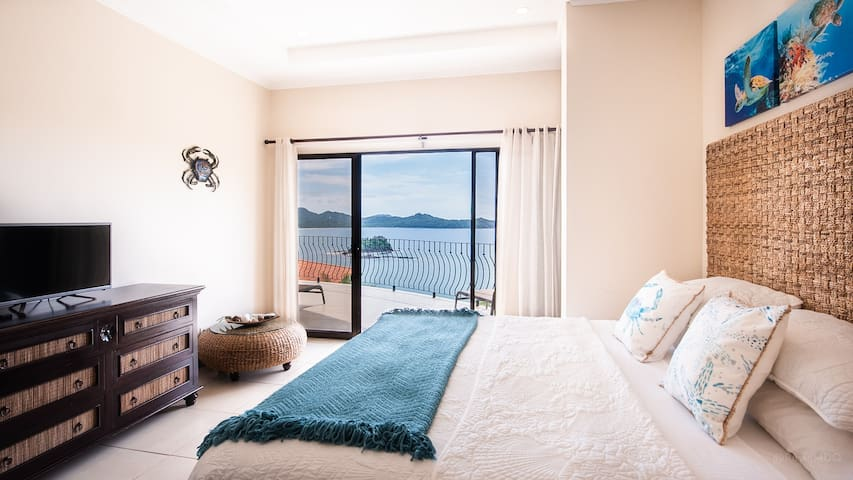 Master bedroom with King bed and access to patio with ocean views.