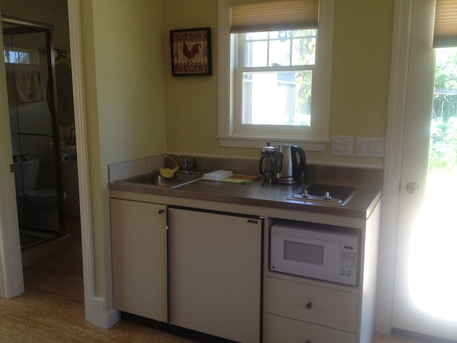Kitchenette includes stove, refrigerator and microwave