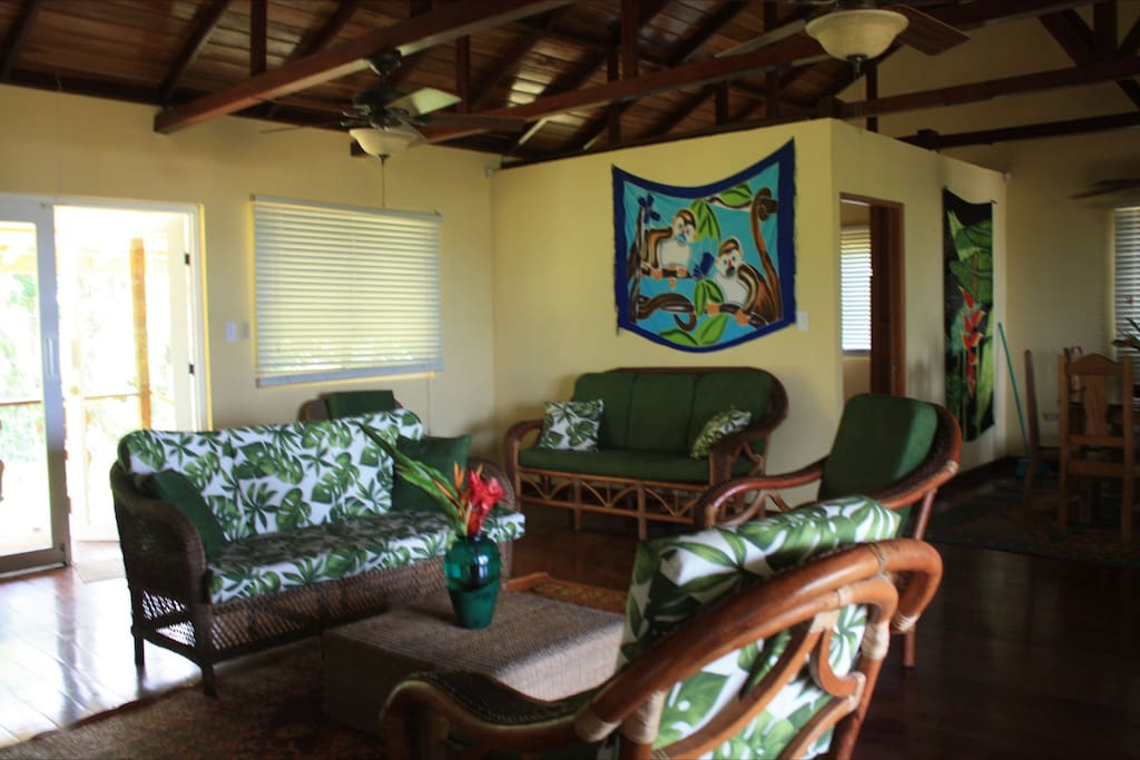 The living room has a variety of couches and chairs to rest in  after an exciting day of exploring this tropical paradise