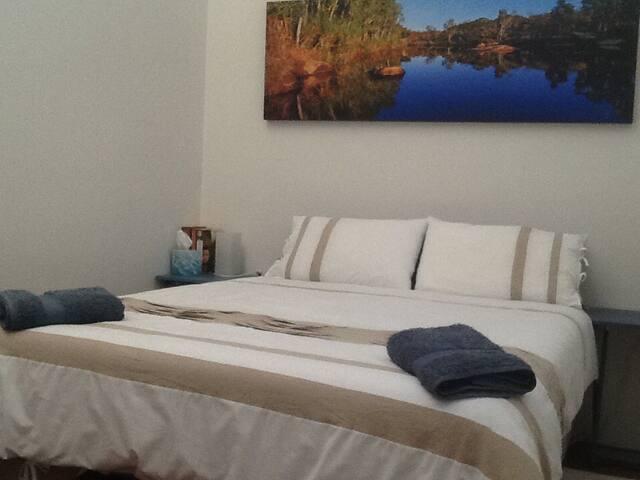 2nd bedroom has 1 queen bed, side tables & wardrobe