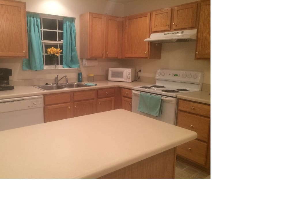 Kitchen is well equipped and the island gives you plenty of work space. The table is to the right of the island.