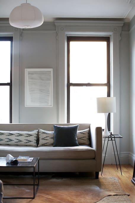 Living room and reclaimed wood bookshelf.