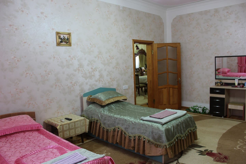 2nd Floor, 3rd Bedroom: 3 single beds, sofa, Wi-Fi,  TV, wardrobe, Air Conditioner.