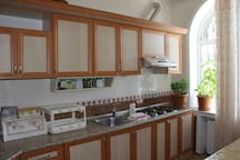 2nd Floor, Kitchen: Fridge, Microwave, TV, Juicer, Bread Toaster for the guests.