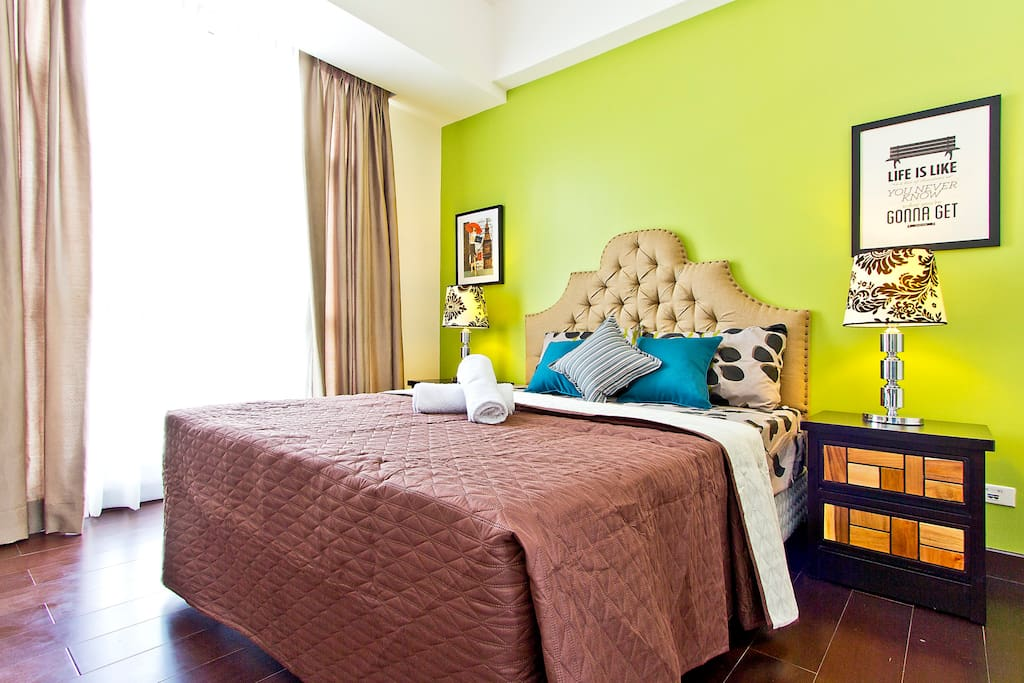 Painted in soothing sage green and beige colors, the bedroom has an incredible view of Antipolo mountain and Laguna Bay
