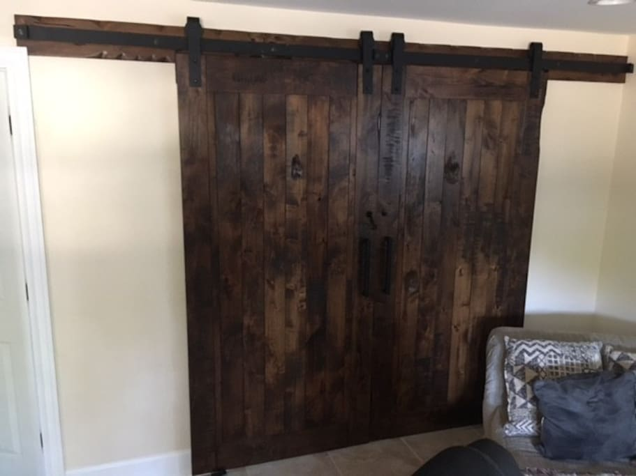 Brand new sliding barn doors for your private room.  Queen sized bed and night stand inside.
